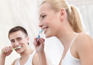 two people brushing teeth in Edmonton