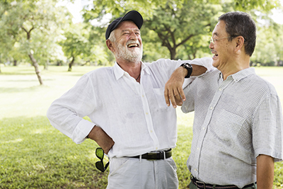 man laughing with his new dentures