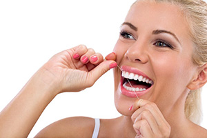 the proper way to floss according to teeth cleaning professionals